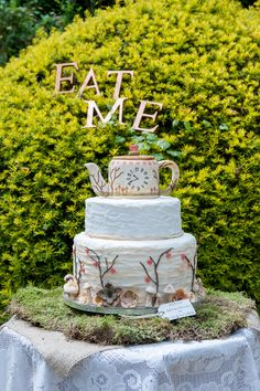 Alice in Wonderland Wedding Cake. Love the 2 signs