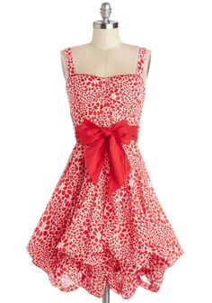 Train Trip Dress in Red Petals. With a vintage hard-shell suitcase at your side, a faux-fur shawl on your shoulders, and the hidden ties of this lined dress pulled to create a pick-up hem, you look ravishing and ready for a day on the tracks. #red #modcloth
