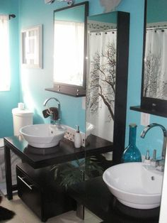With black mirrors and vanities, HGTV fan tiki262 brightened up a dark bathroom with turquoise on the walls, a white-tiled tub surround and flowing white curtains for softness.