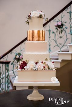 Rose gold wedding cake with hints of Marsala, blush and ivory by Poppy Pickering