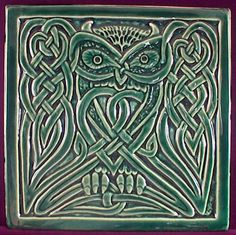 Handmade relief carved ceramic Celtic owl art