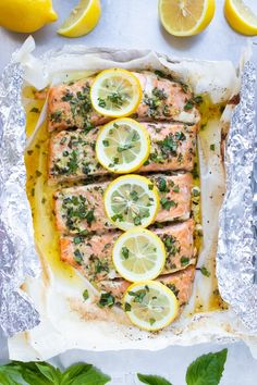 A quick and easy baked salmon recipe that is coated in a butter, lemon and basil sauce, wrapped in foil or parchment paper and then cooked in the oven. It is the best healthy, easy, and low-carb seafo Baked Salmon Recipes, Chicken Pasta Recipes, Fish Recipes, Seafood Recipes, Dinner Recipes, Cooking Recipes, Paleo Dinner, Healthy Recipes, Salmon Recipe Videos