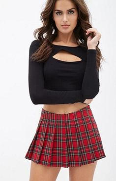 Throwback to those 'Hit Me Baby One More Time'days in this plaid mini skirt. Get it at