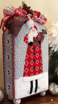 Polly V. Stitched this handsome Mr Claus and I had special fun finishing this one. Too cute.