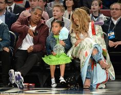 Capturing the moment: Jay took time to snap a picture of his daughter snacking as Beyonce smiled in the background