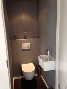 "modern toiletroom design inspiration byCOCOON.com | concrete look | modern bathroom taps | cold water tap | solid surface toilet washbasins ""Sant Jordi"" 