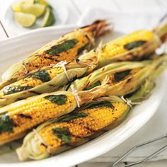 Basil Corn on the Cob Recipe -Steaming the basil under the husks adds lots of flavor to these fantastic ears. Lime makes their sweet taste pop even more. Corn Recipes, Side Dish Recipes, Vegetable Recipes, Recipies, Easy Recipes, Vegan Recipes, Veggie Dishes, Food Dishes, Side Dishes