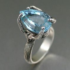 Reminiscent of a mesmerizing deep blue sea, this handmade Sterling Silver Tree Branch Cocktail Ring has a bold presence that leaves you breathless. The exquisite 13 carat Pear Cut Blue Topaz gemstone sits within a hand-carved tree branch setting, perfect  by johnsbrana, via Flickr