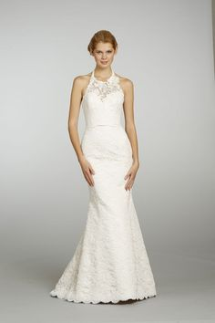 Show off slender shoulders and just a hint of skin in a subtly sexy halterneck wedding dress