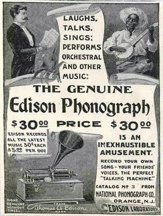 """Edison Phonograph Ad by the Nat'l Phonograph Company.  In the opinion of Neil Lerner, a collector, the phonograph is one of Edison's """"Home"""" units. The model, he says, can be identified by the clips on the side. These clips were used to attach the lid.  Behind the woman's elbow is a hole in the case to insert the crank to wind up the phonograph. A dozen seconds of cranking, and then you could sit back and listen to a 2-minute song, a speech, or a story."""""""