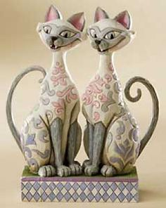 """The Si and Am figurine I have in my china cabinet. Because """"We are Siamese if…"""