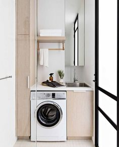 Small but mighty! This compact terrace renovation pairs Japanese-inspired minimalism with contemporary living and clever. Laundry Area, Laundry Storage, Laundry In Bathroom, Closet Storage, Stacking Doors, Compact Laundry, Bedroom With Ensuite, Master Bathrooms, Laundry Room Design