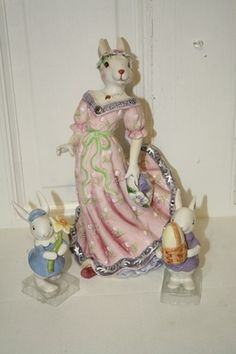 "set of 3 porcelain rabbit figurines. Momma-11.5"" x 6 1/4"" x 6"" rabbit holding flower-5"" rabbit with basket 4.5"". MINT $25"