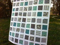 "cute ""ticker tape"" quilt designed to fray around the blocks."