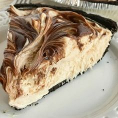 No-bake peanut butter fudge swirl pie is loaded with peanut butter, fudge, and cream cheese inside an easy Oreo cookie crust. So easy to make and the best no bake dessert you will ever eat. If you love peanut butter & chocolate then this pie will become a favorite.