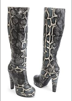 """Black (BK) Snake Print Boot $34  These boots were made for walking on the wild side and that's just what you'll do! ·  Full and half sizes 5.5-9, 10   ·  Heel height 4 1/2"""", platform 1/2""""   ·  Inside zipper up the entire leg of boot   ·  100% Polyurethane  · Style #Z12945 Orig. $49 SALE $34"""