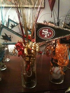 Cute idea of center pieces for sports theme