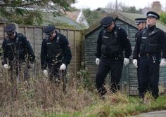 Police carrying out a search in the grounds of Rev Percival's home in Freckleton.  Thomas Temple/Rossparry.co.uk