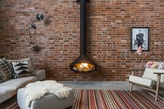 A bespoke flue was manufactured for the wood-burning fireplace to reach the 10-meter ceiling height.