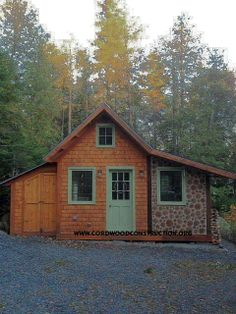 """Anisley Bodman of western Maine built this attractive cordwood addition to her cabin. She is nestled in a welcoming forest setting and loves the way the cordwood log ends """"work"""" with her wood siding."""