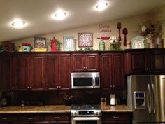 Above Kitchen Cabinet Decor Cabinets Decorations Top Decorating