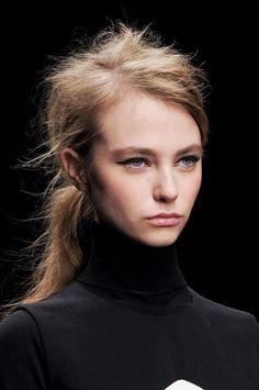 fuzzy ponytail, thick brows, cat eye.   Zoe Jordan FW 13