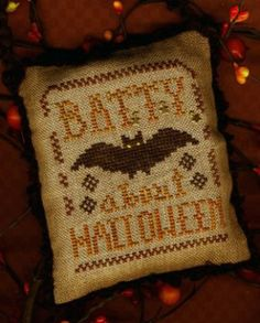 """Batty About Halloween"" is the title of this cross stitch pattern from Homespun Elegance that is stitched with Crescent Colours (Brandied Pears), Weeks Dye Works (Onyx and Rust) and DMC (833)."