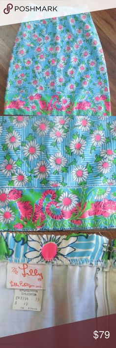 The Lilly Pulitzer Tigers & Daisy Skirt Sz 12 ?For sale is this great Lilly daisies and tigers skirt.  Really bright colors, zips in the back. Small front pocket.  Excellent condition.  Vintage size 12 which is smaller than current sizes.  Thanks for looking! Lilly Pulitzer Skirts Midi