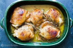 Honey Mustard Chicken! Chicken thighs baked in a simple honey mustard sauce until golden brown, with sprigs of rosemary. 1 pot, 5 ingredients, EASY! On SimplyRecipes.com #HoneyMustard #Chicken #ChickenDinner