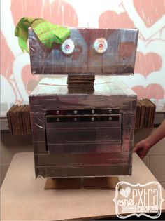 The Cardboard Challenge!  Students work through the engineering design process, incorporate a simple machine into their designs, and write procedural report about their creations!