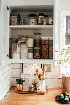 Marie Kondo Tips- Kitchen Organizing- What would Marie Do? I'm writing a weekly series of how we are tidying up and organizing different rooms in our home. This week we are tackling spice and cabinet organization in the kitchen! #kitchenorganization #mariekondo