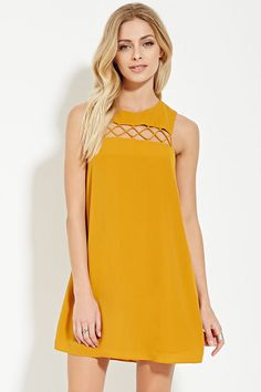 Forever 21 Contemporary - A sleeveless mini dress crafted from a lightly textured woven fabric with a shift silhouette, crisscross detailing at its cutout yoke, and a buttoned keyhole back.