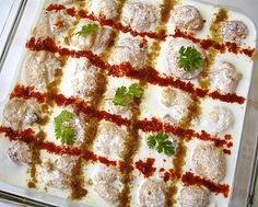 Dahi Vada - Deep fried lentil balls dunked in curd sauce and served with tamarind chutney