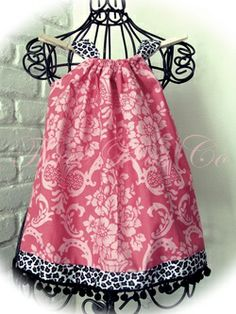Love the pattern on this pillowcase dress with the contrast bottom ribbon. Cute!
