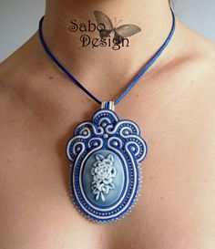 Soutache pendant in navy blue ecru cameo rose by SaboDesign.