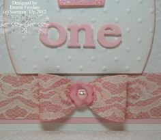"""Paper bow   """"Here's a closer look at the bow. It really is easy, 2 oval shapes folded in half and secured in the centre. I used a little pink button and topped that off with the 1/2 pearl. The possibilities are endless once you know how to make one."""""""