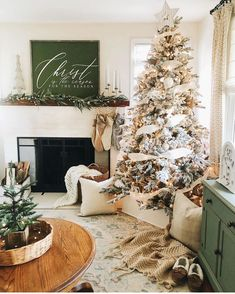 Farmhouse Christmas decor with fireplace mantle and queen flicked tree. Neutral Christmas holiday decor with white tree box. Green, gold, white, and great holiday decor Christmas Living Rooms, Christmas Room, Christmas Tree Themes, Cozy Christmas, Christmas Holidays, Living Room Holiday Decor, Cool Christmas Decorations, Beautiful Christmas, Xmas