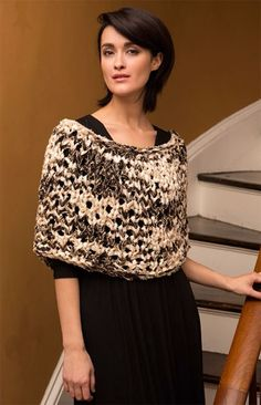 You probably have used Sashay yarn for ruffles...but here is what happens when you use Sashay Boho like a yarn and knit with it! This classic poncho silhouette looks wonderful on all body types and has the added dimension of small sequins.