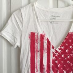American eagle graphic v neck tee! 100% cotton. Red American flag on front. Great for Memorial Day or Fourth of July coming up! No pulls holes or stain, needs ironed. BUNDLE FOR FREE SHIPPING American Eagle Outfitters Tops Tees - Short Sleeve