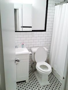 Bathroom - nice combination of small subway tile & checkered black and white floor tile.