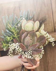 succulent and babys breath bouquet