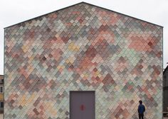 Colourful scales front Assemble's Yardhouse studios for east London creatives (dezeen)