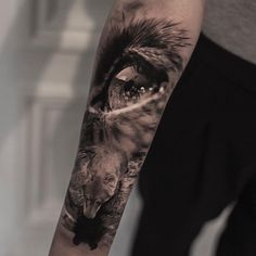 Into the Wild tattoo by Bro Studio Amazing black and grey realistic tattoo style of Into the Wild motive done by tattoo artist Bro Studio Wolf Tattoos, Wolf Eye Tattoo, Wolf Tattoo Sleeve, Elephant Tattoos, Animal Tattoos, Body Art Tattoos, Hand Tattoos, Girl Tattoos, Sleeve Tattoos