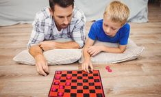 ▰ [GET]◿ Father And Son Playing Checker Game While Lying On Hardwood Floor At Home Board Game Bonding Boy Caucasian Chance Father Games, Picnic Blanket, Outdoor Blanket, Hardwood Floors, Flooring, Male Man, Father And Son, Board Games, Sons