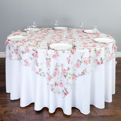 Three-dimensional flowers are the magic behind our alluring 72 in. Square Sheer with Pink Roses Overlays. Featuring sheer material with a rose and foliage pattern and 3 dimensional roses, this table topper will bring enchantment and romance to your event, whether a Victorian-themed wedding, Secret Garden themed wedding, tea party, sweet 16, Quinceanera, or bridal shower. Overlay is best suited for a 60 inch round table.