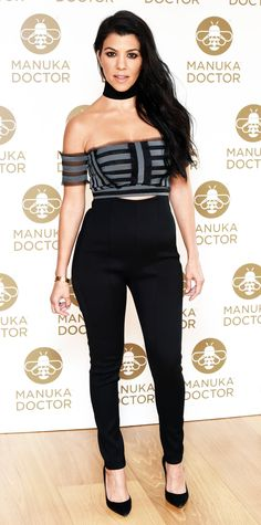 Kourtney Kardashian gave the cold shoulder in hot look during a photocall that celebrated her appointment as global brand ambassador for Manuka Doctor. She wore a paneled Erdem off-the-shoulder crop top and high-waist black pants, styling the combo with a black choker and classic black pumps.
