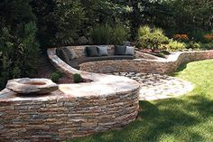 Architect Carol Cioppa was inspired by Andrew Goldsworthy's serpentine walls to create this sheltered seating area overlooking the pool and gardens at this Pound Ridge residence. Cioppa Architects, LLC (914) 764-1549 cioppaarchitectsllc.blogspot.com