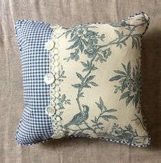 Absolutely stunning! We have used blue bird linen fabric pared with a gorgeous blue check cotton and vintage lace and vintage buttons. The back of this pillow is done in the blue bird linen with blue check piping. A one of a kind for sure! Front and back, shes a beauty! Perfect