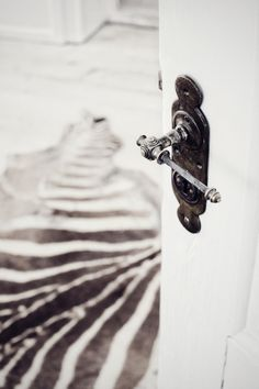The perfect shot! Beautiful #Vintage style doorknob with a #Modern zebra rug!