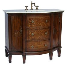"""Dimensions: 42.5 x 21.5 x 36.5""""H. approx. Redecorate using our uniquely styled Algaringo bathroom sink vanity. This French design fully detailed vanity is meticulously handcrafted featuring durable wo"""